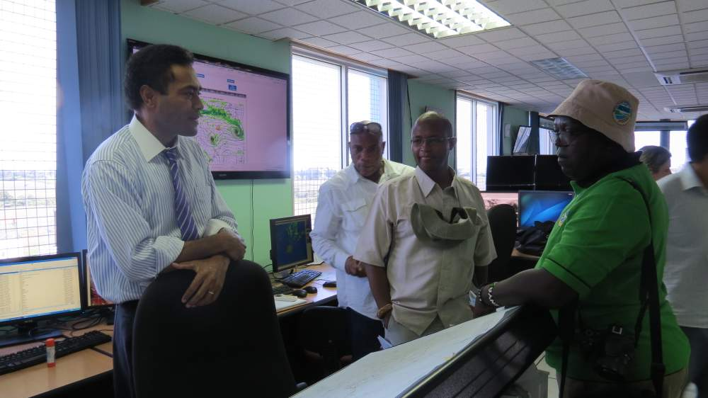 Meteorologists at the Fiji Meteorological Service in Nadi, Fiji, discuss climate and weather technologies and patterns with representatives from Jamaica and Kenya.