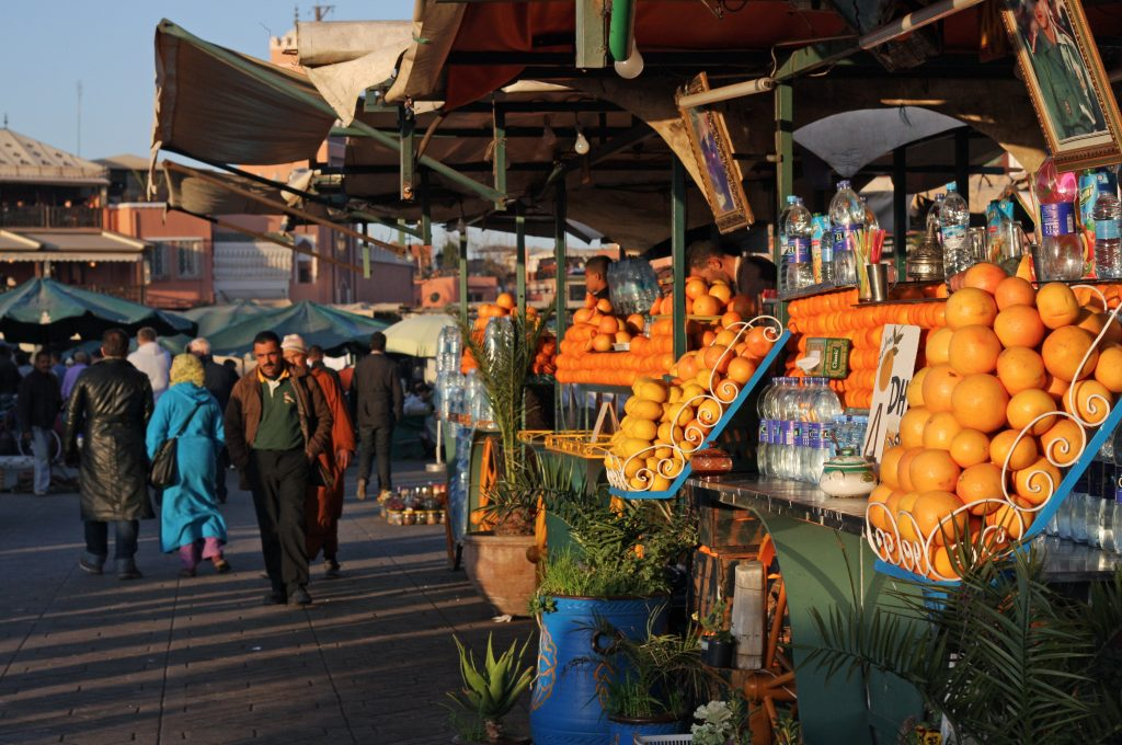 Marrakesh, Morocco - September 12, 2014: Market booth with fresh fruits and juices on the main city square in Marrakesh.